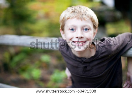 Portrait of a cute young boy outside - stock photo