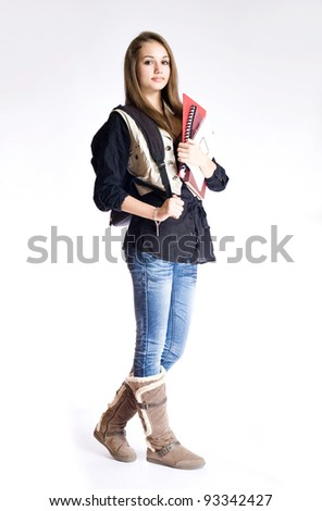 Portrait of a cute young brunette student girl with exercise books. - stock photo