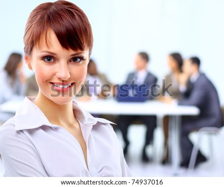 Portrait of a cute young business lady looking happy at office - stock photo