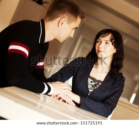 Portrait of a cute young couple in love sitting together at home  - stock photo