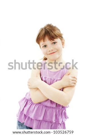 Portrait of a cute young girl standing with folded hands over white background