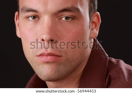 portrait of a cute young man, beige background