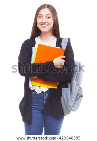 Portrait of a cute young student girl holding colorful notebooks, isolated on white background