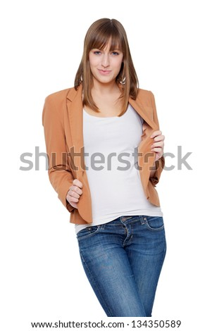 Portrait of a cute young woman holding jacket - stock photo