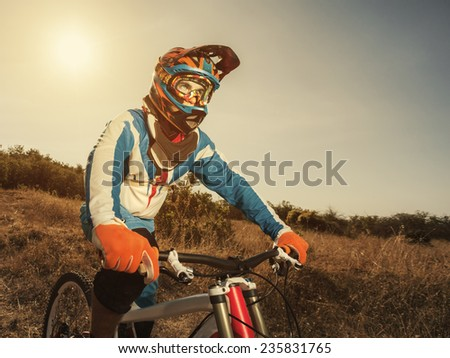 Portrait of a cyclist on a mountain bike. Active sport in nature. - stock photo