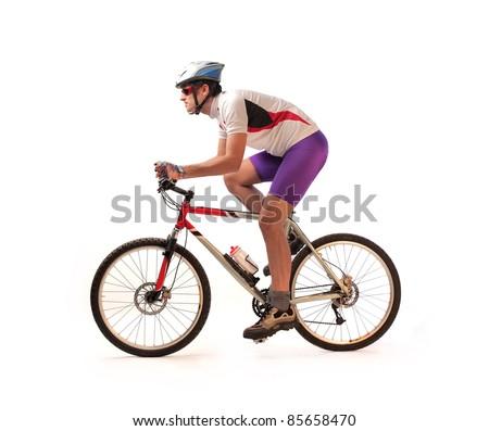 Portrait of a cyclist riding a bike - stock photo