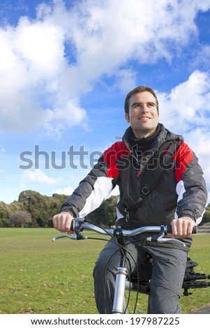 Portrait of a cyclist young adult smiling - stock photo
