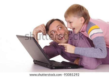 portrait of a daddy and son at computer