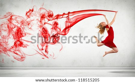 Portrait of a dancing young woman with red smoke