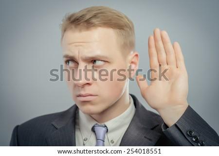 Portrait of a deaf businessman - stock photo