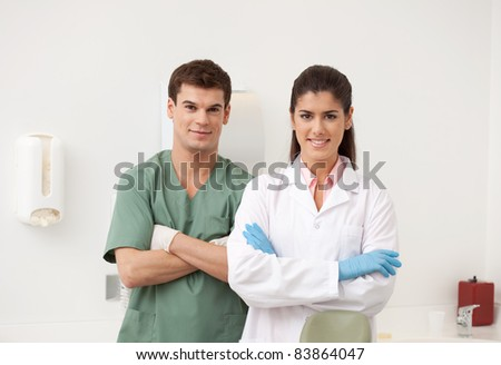 Portrait of a dental team, smiling at the camera - stock photo