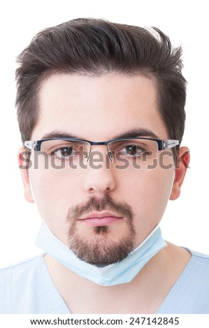 Portrait of a dentist male with a serious face isolated on white background