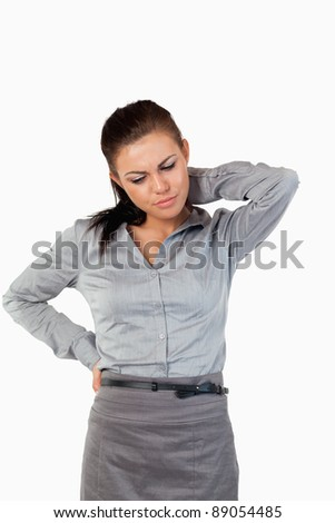Portrait of a depressed businesswoman having back pain against a white background