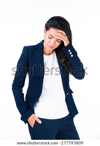 Portrait of a depressed businesswoman standing over white background