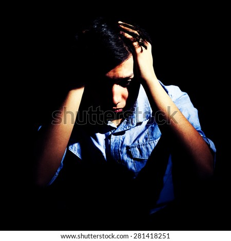 Portrait of a depressed man, intentionally toned - stock photo