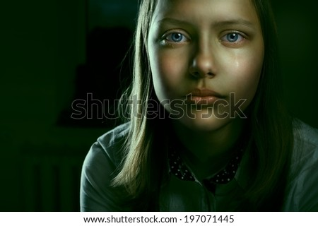 Portrait of a depressed teen girl, studio shot - stock photo