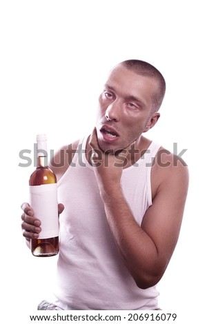 Portrait of a depressed weird drunk guy with bottle  - stock photo
