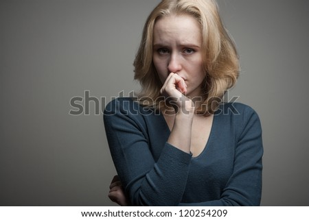 portrait of a depressed young  lonely woman - stock photo