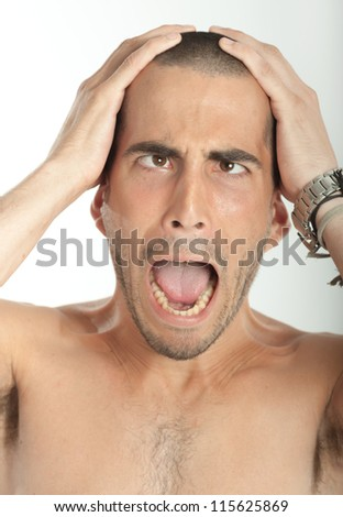Portrait of a desperate funny young man - stock photo