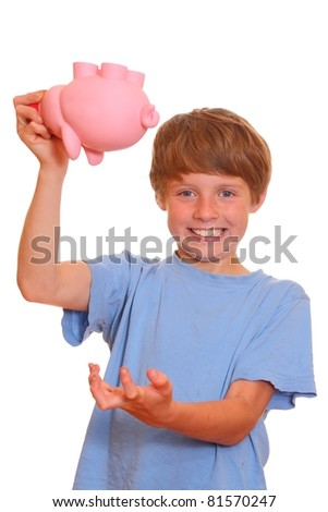 Portrait of a desperate teenage boy trying to empty his piggy bank - stock photo
