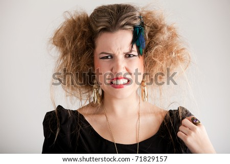 Portrait of a disgusted woman with messy hairdo - stock photo