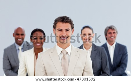 Portrait of a diverse business team standing - stock photo