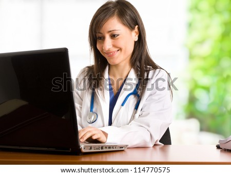 Portrait of a doctor using her personal computer