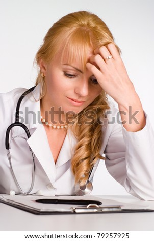 portrait of a doctor working at table