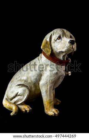 Portrait of a dog sculpture on a black background, whole body, color