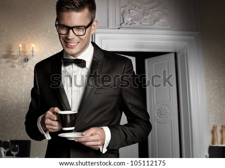 Portrait of a elegant man with cup of coffee - stock photo