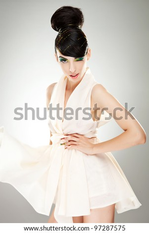 Portrait of a elegant woman winking for the camera - stock photo