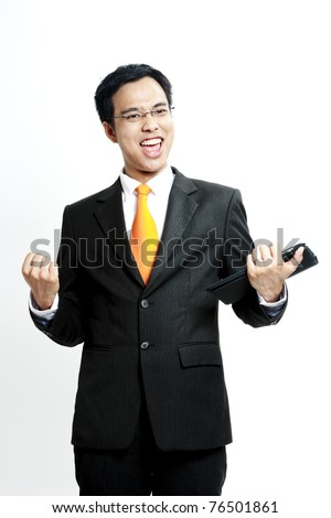 Portrait of a energetic young businessman enjoying success against white - Isolated