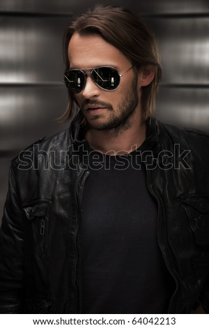 Portrait of a enigmatic man - stock photo
