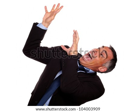 Portrait of a excited hispanic businessman screaming with hands up while falling down against white background - stock photo