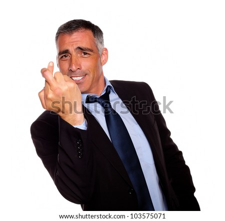 Portrait of a executive crossing the fingers on black and blue suit against white background - stock photo