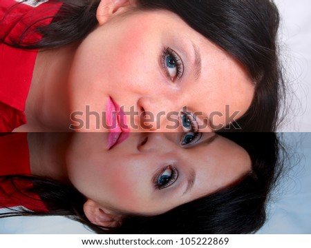 portrait of a face in the mirror reflection - stock photo