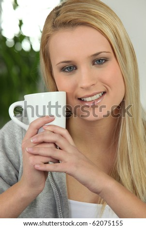 Portrait of a fair-haired woman with a cup