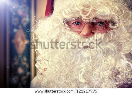 Portrait of a fairy Santa Claus at home.