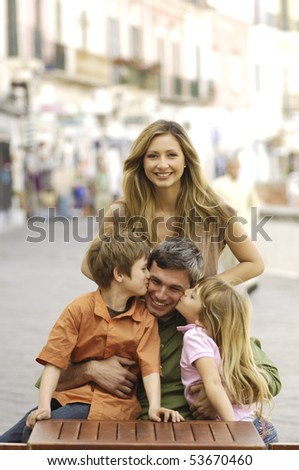 Portrait of a family at a cafe - stock photo