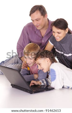 portrait of a family at laptop on white