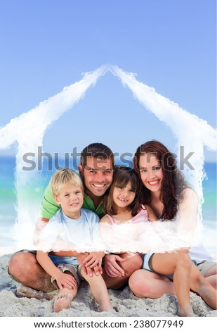 Portrait of a family at the beach against house outline in clouds - stock photo