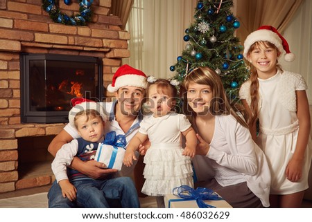 portrait of a family. celebrating Christmas at home. father, mother and children on the background of the Christmas tree. New Year and xmas people