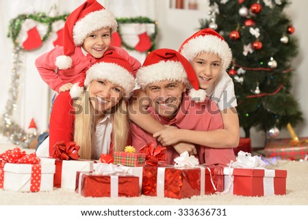 Portrait of a family celebrating New Year at home - stock photo