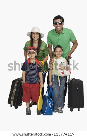 Portrait of a family going for vacations - stock photo