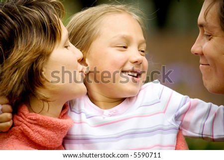 portrait of a family in a casual and happy moment - stock photo