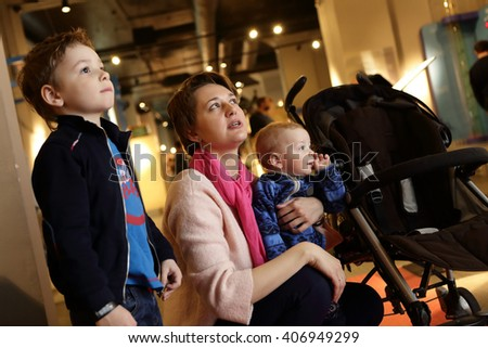 Portrait of a family in the museum - stock photo