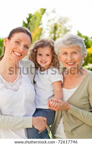 Portrait of a family looking at the camera - stock photo