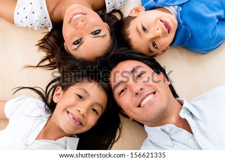Portrait of a family looking very happy and smiling  - stock photo