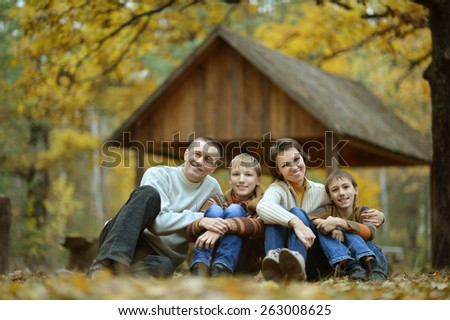 Portrait of a family of  four in autumn forest - stock photo