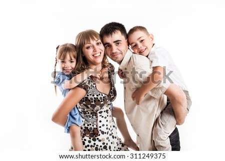 portrait of a family of 4 on a white background in studio - stock photo